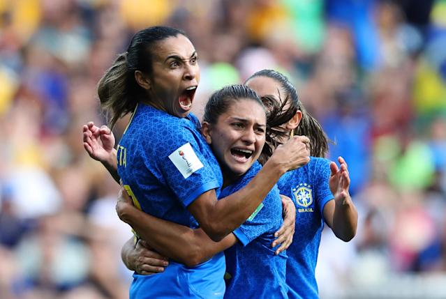 Marta of Brazil celebrates with teammates after scoring her team's first goal during the 2019 FIFA Women's World Cup France group C match between Australia and Brazil at Stade de la Mosson on June 13, 2019 in Montpellier, France. (Photo by Elsa/Getty Images)
