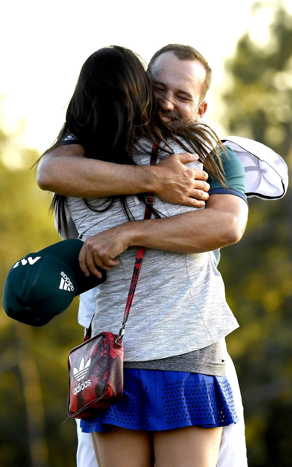 Sergio Garcia celebrates with fiance Angela Akins - Credit: REX FEATURES