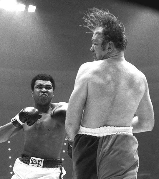 <p>Heavyweight boxer Muhammad Ali hits Chuck Wepner during a heavyweight title fight on March 24, 1975 at the Richfield Coliseum in Richfield, OH. Ali won the bout with a TKO in the 15th round.<br>1975 Paul Tepley Collection/Diamond Images</p>