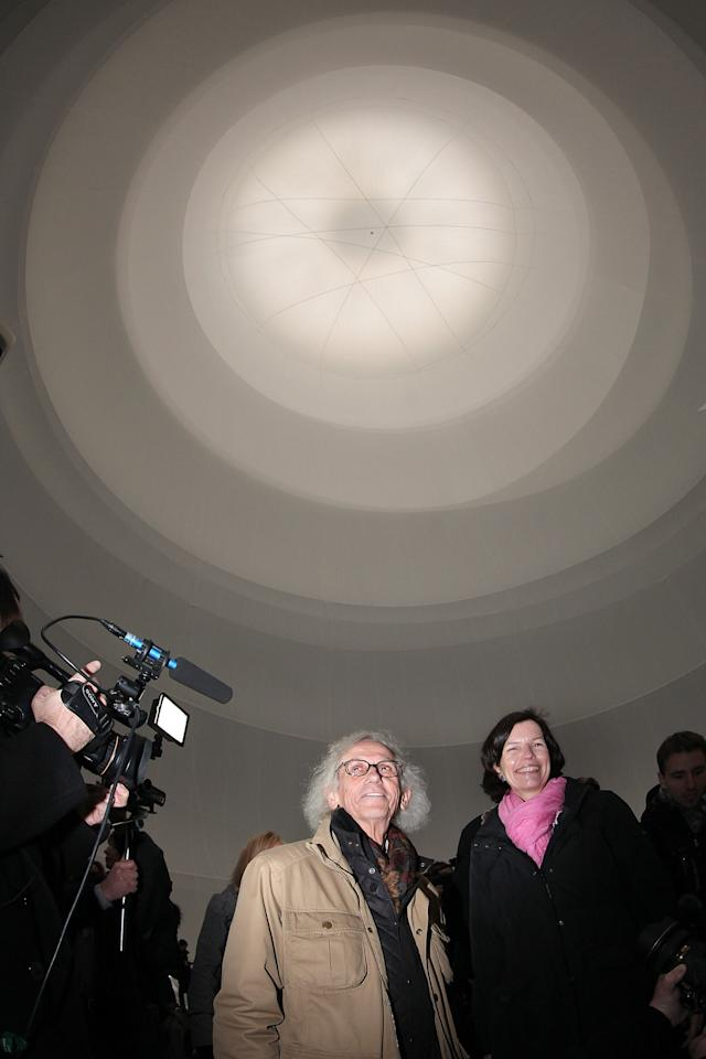OBERHAUSEN, GERMANY - MARCH 15: Curator Jeanette Schmitz and Bulgarian-born artist Christo, known for his large-scale environmental art, leads journalists through his Big Air Package, his latest work in a former gas storage facility called the Gasometer on March 15, 2013 in Oberhausen, Germany. The piece is made from 5.3 tons of translucent material covering 20,350 square meters and shaped with 4.500 meters of cable, and fills the interior of the facility. The installation will be open to the public from March 16 through December 30. (Photo by Hannelore Foerster/Getty Images)