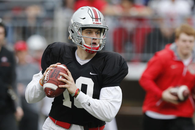 Ohio State quarterback Joe Burrow drops back to pass during their NCAA college spring football game Saturday, April 14, 2018, in Columbus, Ohio. (AP Photo/Jay LaPrete)
