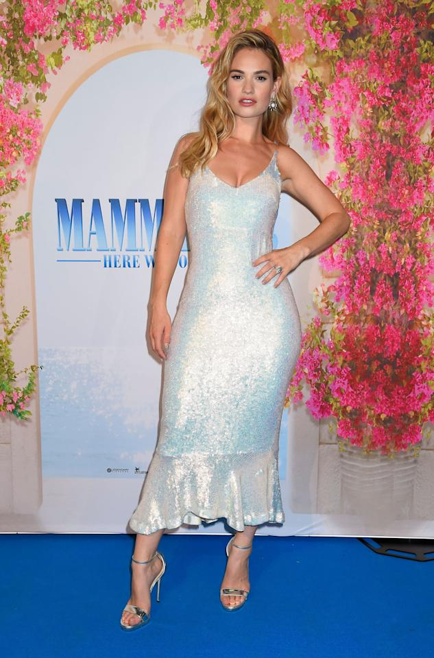 <p>Lily James looked gorgeous at the premiere wearing a sequinned fishtail dress by Saloni, the eponymous brand of Indian-born designer SaloniLodha. We love the iridescent sheen.<br /><em>[Photo: Rex]</em> </p>