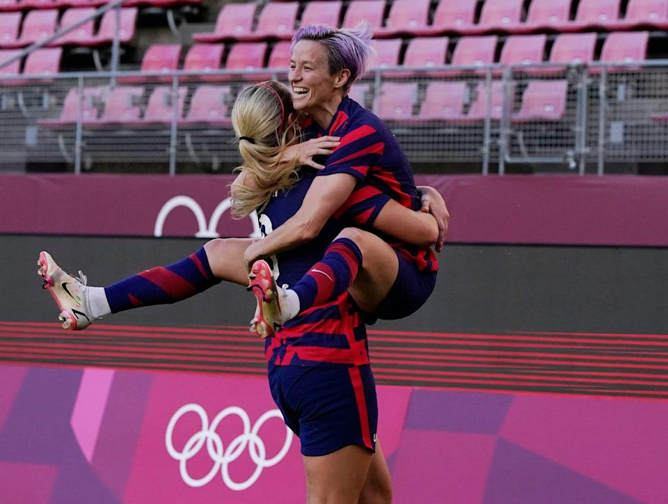 Megan Rapinoe celebrates with teammate Lindsey Horan after one of her two first-half goals in the bronze medal game.