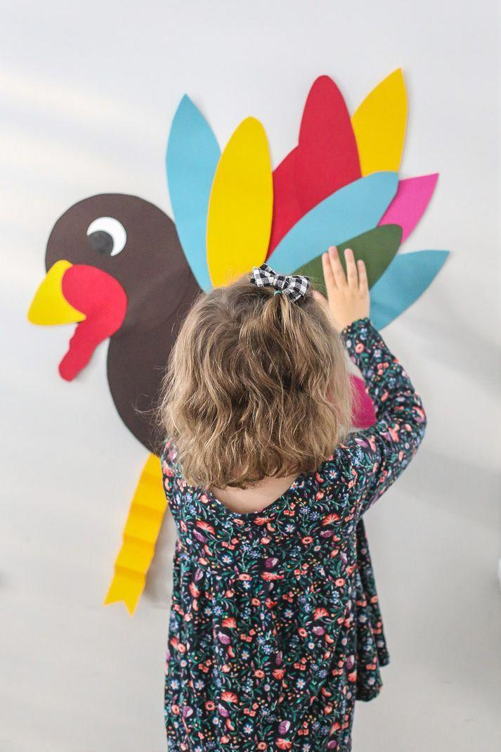 """<p>You can set up this game two different ways: Craft your very own Thanksgiving turkey with some construction paper, or save time and <a href=""""https://www.amazon.com/Amscan-Festive-Thanksgiving-Activities-Multicolor/dp/B00G4F6VJO/?tag=syn-yahoo-20&ascsubtag=%5Bartid%7C10050.g.4698%5Bsrc%7Cyahoo-us"""" rel=""""nofollow noopener"""" target=""""_blank"""" data-ylk=""""slk:buy a similar version"""" class=""""link rapid-noclick-resp"""">buy a similar version</a>.</p><p><strong>Get the tutorial at <a href=""""https://thelittlesandme.com/3-kid-approved-friendsgiving-activities/"""" rel=""""nofollow noopener"""" target=""""_blank"""" data-ylk=""""slk:The Littles and Me"""" class=""""link rapid-noclick-resp"""">The Littles and Me</a>.</strong></p><p><a class=""""link rapid-noclick-resp"""" href=""""https://www.amazon.com/SunWorks-Construction-9-Inches-12-Inches-100-Count/dp/B0017OJKLI/?tag=syn-yahoo-20&ascsubtag=%5Bartid%7C10050.g.4698%5Bsrc%7Cyahoo-us"""" rel=""""nofollow noopener"""" target=""""_blank"""" data-ylk=""""slk:SHOP CONSTRUCTION PAPER"""">SHOP CONSTRUCTION PAPER</a></p>"""