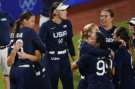 Members of team United States react after a softball game against Japan at the 2020 Summer Olympics, Tuesday, July 27, 2021, in Yokohama, Japan. Japan won 2-0. (AP Photo/Matt Slocum)