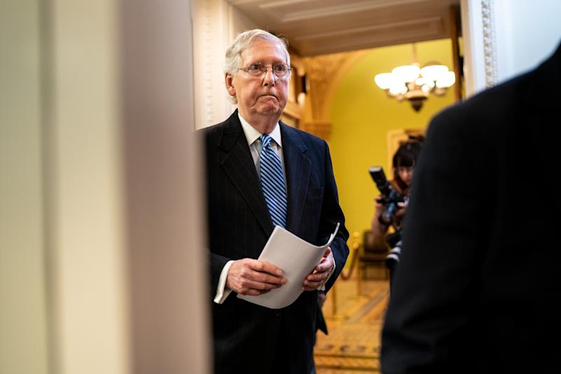 Senate Majority Leader Mitch McConnell (R-Ky.) walks to a news conference after the Senate voted to acquit the president, on Capitol Hill in Washington, Feb. 5, 2020. (Erin Schaff/The New York Times)