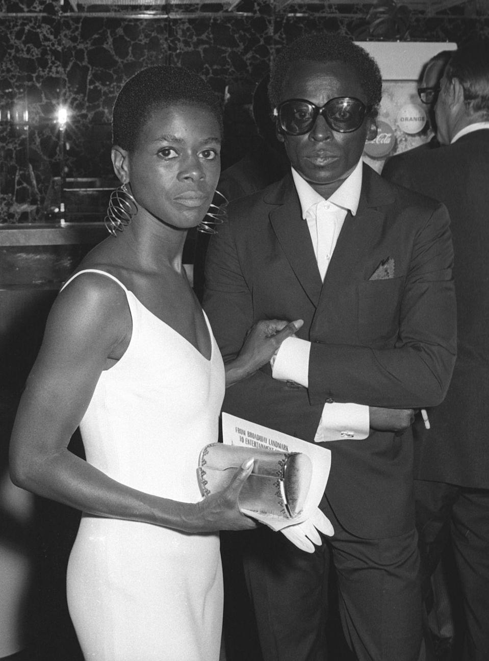 <p>Cicely Tyson's love affair with Miles Davis is legendary, and in spite of their tumultuous history, she considered him the love of her life up until her death. Here she is with Davis at the premiere of <em>The Heart is a Lonely Hunter</em>, wearing a slinky white gown and rocking her iconic TWA (Teeny Weeny Afro)</p>