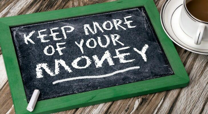 """""""KEEP MORE OF YOUR MONEY"""" written on a chalk board"""