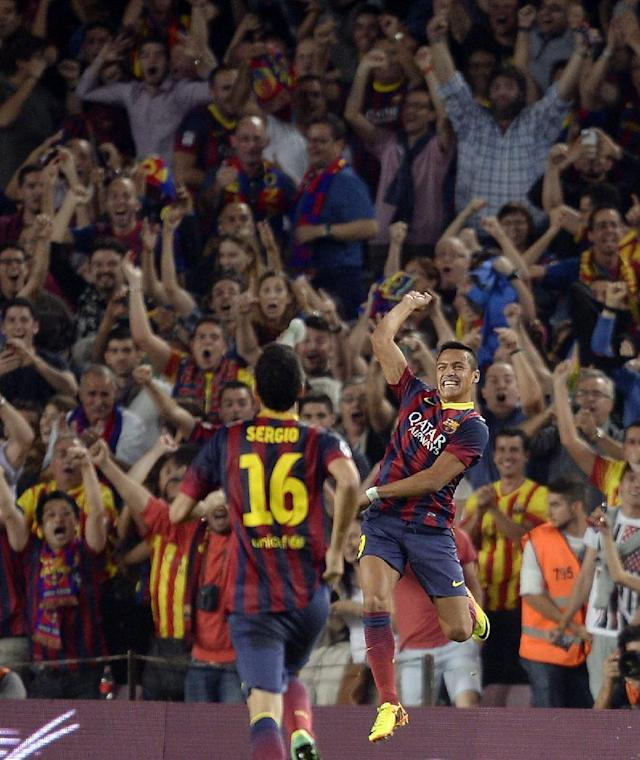 FC Barcelona's Alexis Sanchez, right, reacts after scoring against Real Madrid during a Spanish La Liga soccer match at the Camp Nou stadium in Barcelona, Spain, Saturday, Oct. 26, 2013. (AP Photo/Manu Fernandez)