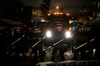 Police in tactical gear form a line facing demonstrators near the location where Walter Wallace, Jr. was killed by two police officers on October 27, 2020 in Philadelphia, Pennsylvania
