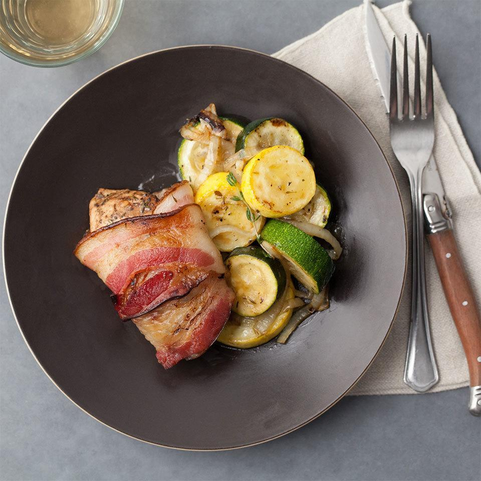 <p>We wrap tender chicken with strips of bacon that crisp up when placed under the broiler. It's a fast recipe for a satisfying, healthy meal.</p>