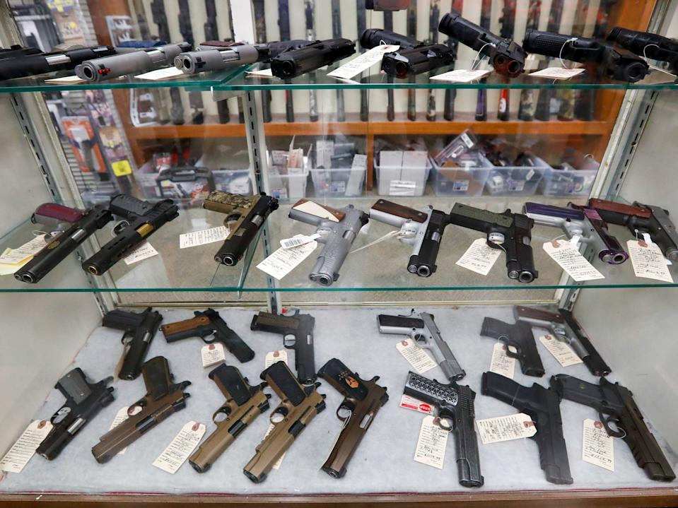 In this March 25, 2020, file photo semi-automatic handguns are displayed at shop in New Castle, PA.  (AP)