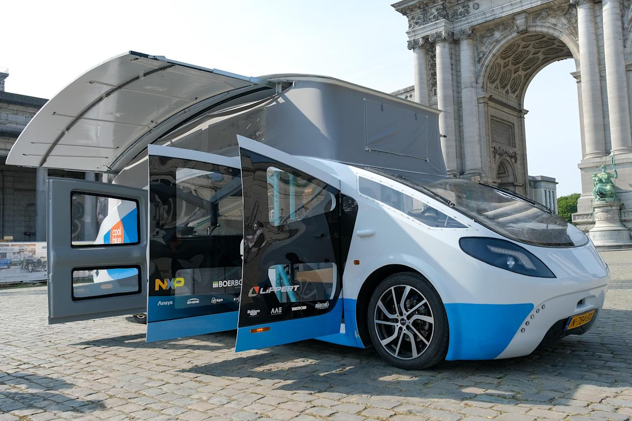 Photo taken on Sept. 20, 2021 shows Stella Vita, a solar-powered recreational vehicle, in Brussels, Belgium.  Designed by the solar team of Eindhoven University of Technology, Stella Vita is equipped with solar panels on the roof, through which the vehicle generates enough energy to drive, shower, watch TV, charge, etc. By using energy efficiently, Stella Vita can travel up to 730 km on a sunny day. (Photo by Zhang Cheng/Xinhua via Getty Images)