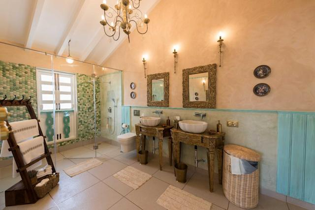 Its ensuite bathroom is lavish with His & Her shower cubicles and washbasins.