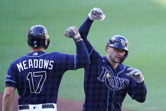 Tampa Bay Rays' Mike Zunino celebrates with Tampa Bay Rays' Austin Meadows after hitting a solo home run against Houston Astros' Lance McCullers Jr. during the seventh inning in Game 2 of a baseball American League Championship Series, Monday, Oct. 12, 2020, in San Diego. (AP Photo/Gregory Bull)