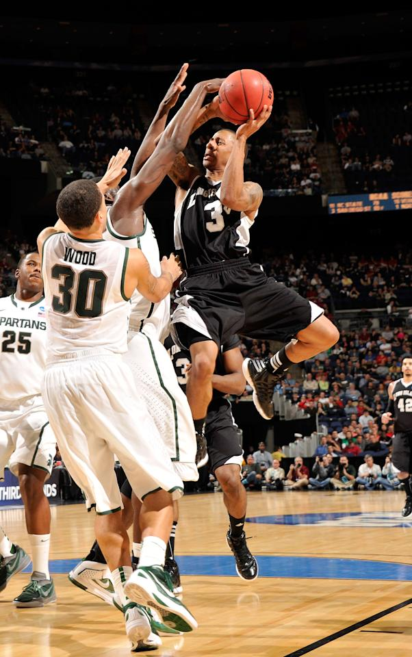 COLUMBUS, OH - MARCH 16: C.J. Garner #3 of the LIU Brooklyn Blackbidrds rives to the basket against Brandon Wood #30 of the Michigan State Spartans in the second half during the second round of the 2012 NCAA Men's Basketball Tournament at Nationwide Arena on March 16, 2012 in Columbus, Ohio.  (Photo by Jamie Sabau/Getty Images)