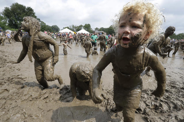<p>Kids play in the mud during Mud Day at the Nankin Mills Park, July 11, 2017 in Westland, Mich. (Photo: Carlos Osorio/AP) </p>