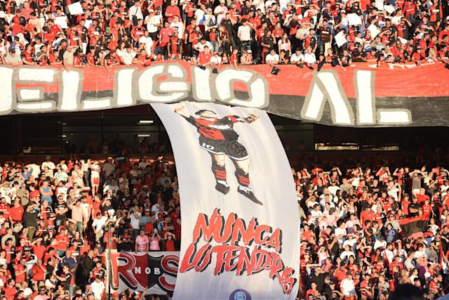 Newell's fans also honoured Maradona with a flag. (Photo by Luciano Bisbal/Getty Images)