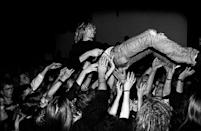 <p>Kurt Cobain crowd surfing at a performance in 1991. </p>