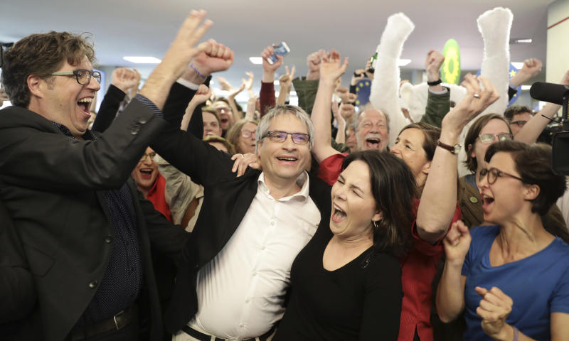 Green party chairwoman Annalena Baerbock and EU parliament member Sven Giegold celebrate after the first results in Berlin, Germany, Sunday, May 26, 2019. (Kay Nietfeld/dpa via AP)