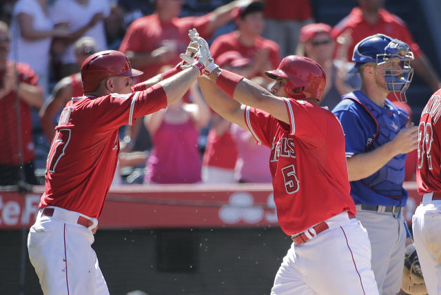 Los Angeles Angels' Albert Pujols, right, celebrates his two-run home run with Los Angeles Angels' Mike Trout during the seventh inning of a baseball game against the Toronto Blue Jays on Wednesday, July 9, 2014, in Anaheim, Calif. (AP Photo/Jae C. Hong)