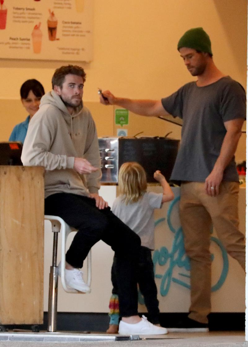 Liam Hemsworth was spotted for the first time yesterday getting frozen yoghurt with his brother, Chris Hemsworth, and his nieces and nephew. Photo: Mega