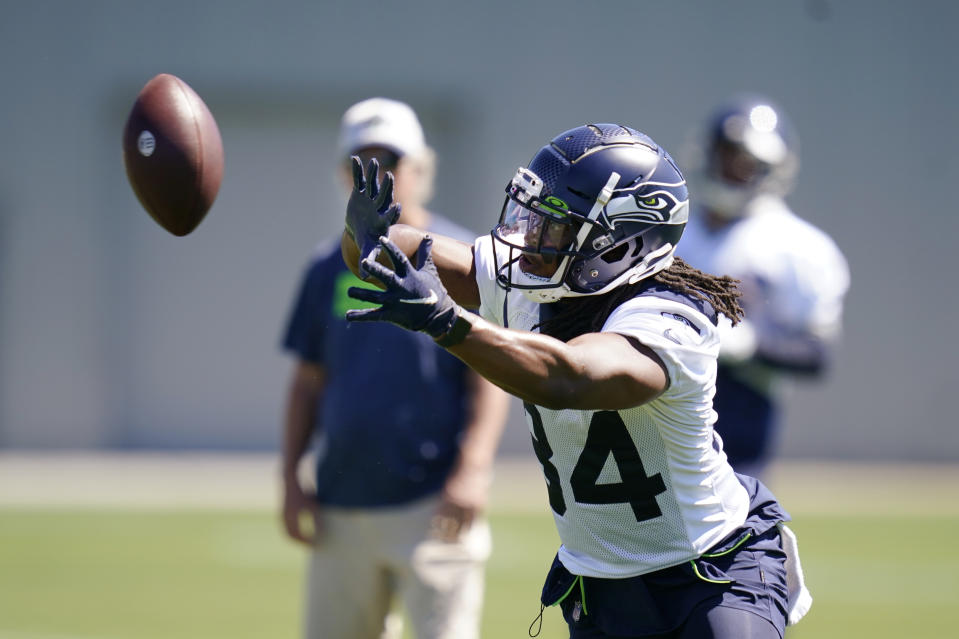 Seattle Seahawks running back Josh Johnson reaches for the ball during an NFL football practice in Renton, Wash., Wednesday, Aug. 11, 2021. (AP Photo/Elaine Thompson)