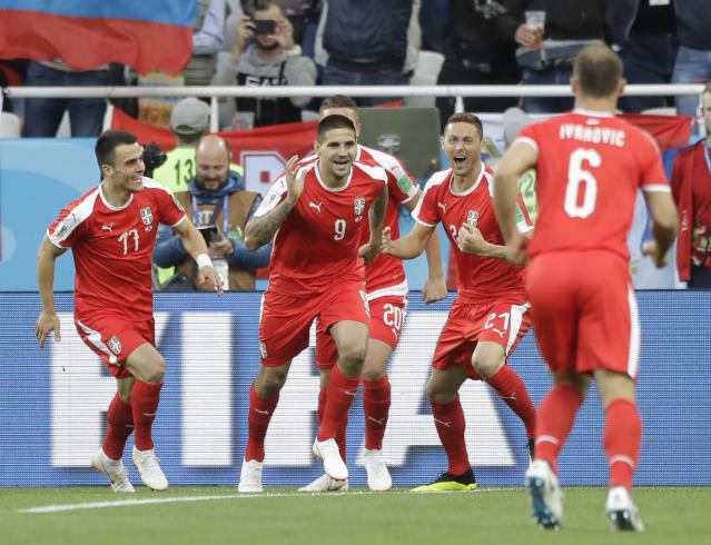 Serbia's Aleksandar Mitrovic, centre, celebrates with teammates after scoring the opening goal during the group E match between Switzerland and Serbia at the 2018 soccer World Cup in the Kaliningrad Stadium in Kaliningrad, Russia, Friday, June 22, 2018. (AP Photo/Matthias Schrader)