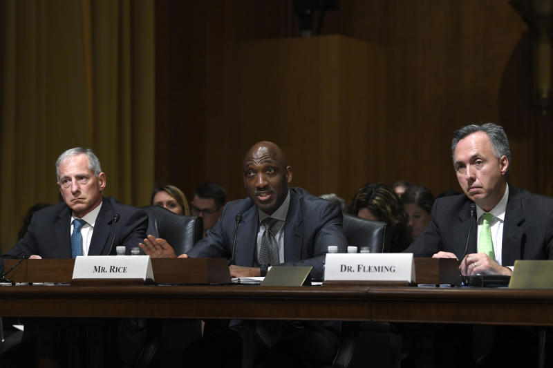 CVS Caremark President and CVS Health Executive Vice President Derica Rice, center, flanked by Cigna Corporation Executive Vice President and Chief Clinical Officer Steve Miller, left, and Humana Healthcare Services Segment President William Fleming, right, testifies before the Senate Finance Committee on Capitol Hill in Washington, Tuesday, April 9, 2019, during a hearing to explore the high cost of prescription drugs. (AP Photo/Susan Walsh)