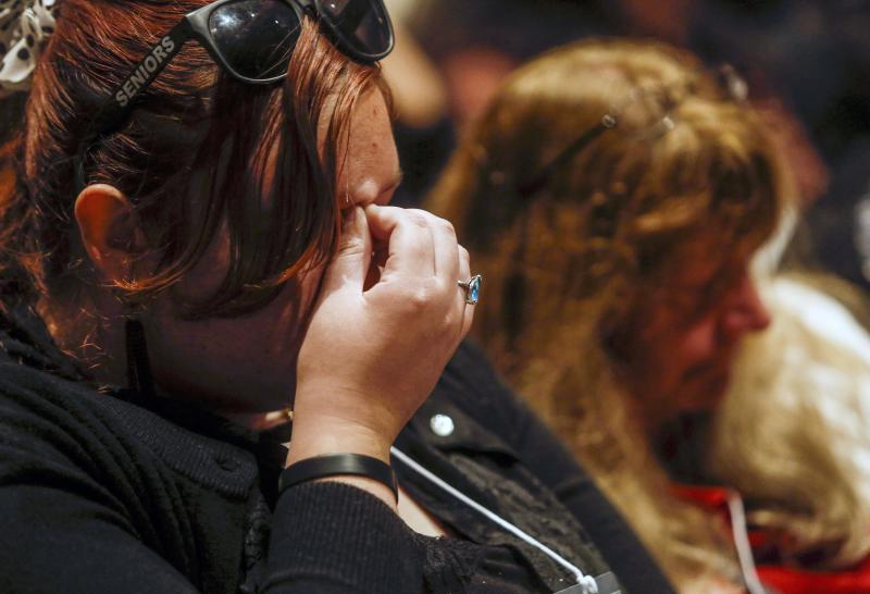Renee Ruffcorn reflects during a moment of silence for those killed in a chartered bus crash in Arcata, California