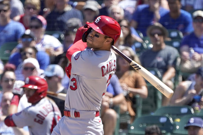 St. Louis Cardinals' Dylan Carlson watches his RBI double during the fifth inning of a baseball game against the Chicago Cubs, Friday, June 11, 2021, in Chicago. (AP Photo/Charles Rex Arbogast)