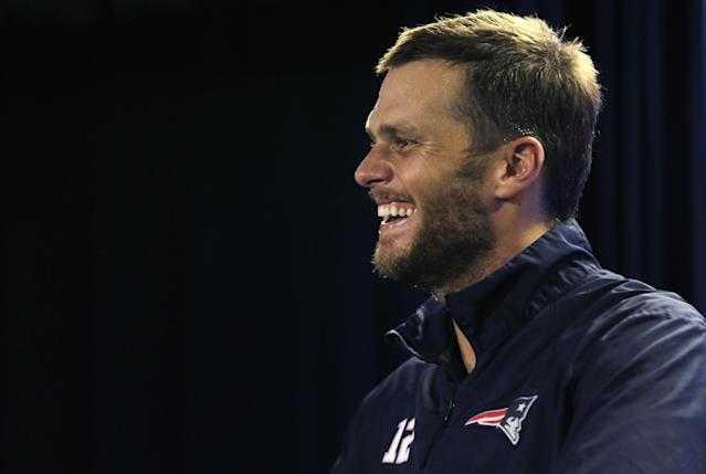 New England Patriots quarterback Tom Brady smiles as he answers a reporter's question after an NFL football practice in Foxborough, Mass., Wednesday, Aug. 20, 2014. (AP Photo/Charles Krupa)