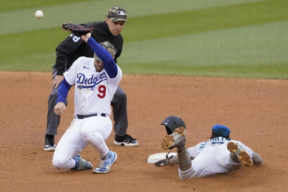 Miami Marlins' Jazz Chisholm Jr., right, steals second base as Los Angeles Dodgers shortstop Gavin Lux (9) loses control of the ball during the seventh inning of a baseball game Sunday, May 16, 2021, in Los Angeles. (AP Photo/Ashley Landis)