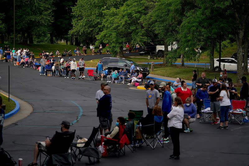 FILE PHOTO: People wait outside Kentucky Career Center in Frankfort