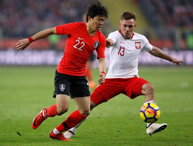 Soccer Football - International Friendly - Poland vs South Korea - Silesian Stadium, Chorzow, Poland - March 27, 2018 South Korea's Kwon Chang-hoon in action with Poland's Maciej Rybus REUTERS/Kacper Pempel