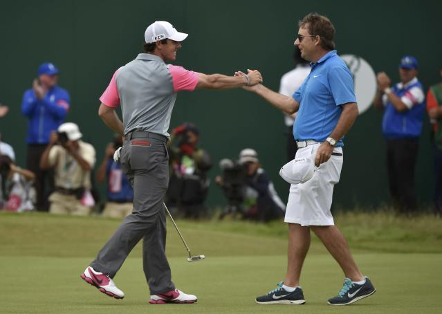 Rory McIlroy of Northern (L) Ireland celebrates with his caddie J.P. Fitzgerald on the 18th green after winning the British Open Championship at the Royal Liverpool Golf Club in Hoylake, northern England July 20, 2014. REUTERS/Toby Melville (BRITAIN - Tags: SPORT GOLF)