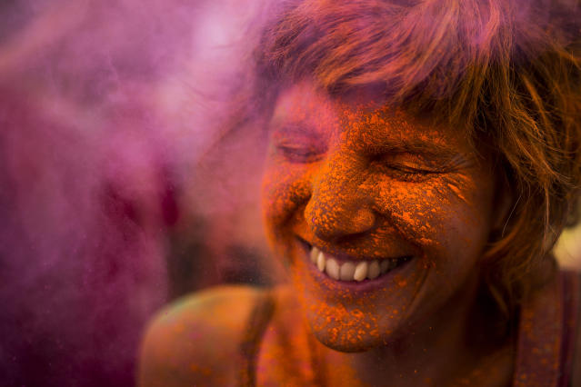 <p>A reveler is covered in colored powder during the Monsoon Holi Festival in Madrid, Aug. 9, 2014. (AP Photo/Andres Kudacki) </p>