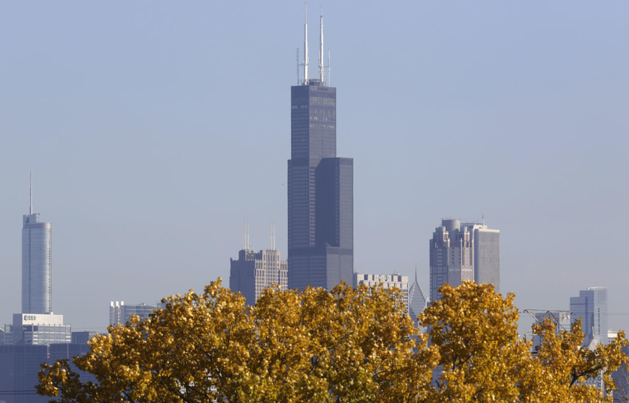 FILE - This Nov. 7, 2013, photo shows a partial view of Chicago's 110 story, 1,450 foot Willis Tower. The Tower is in contention with the 104-story, 1,776 foot One World Trade Center, a skyscraper built at the site of the 9/11 attacks on the World Trade Center in New York as the tallest building in America. A committee of architects recognized as the arbiters on world building heights is meeting Friday Nov. 8, 2013 in Chicago to decide whether a design change affecting One World Trade Center's needle disqualifies its hundreds of feet from being counted, which would deny the building the title of nation's tallest giving the title to Willis Tower. (AP Photo/M. Spencer Green)