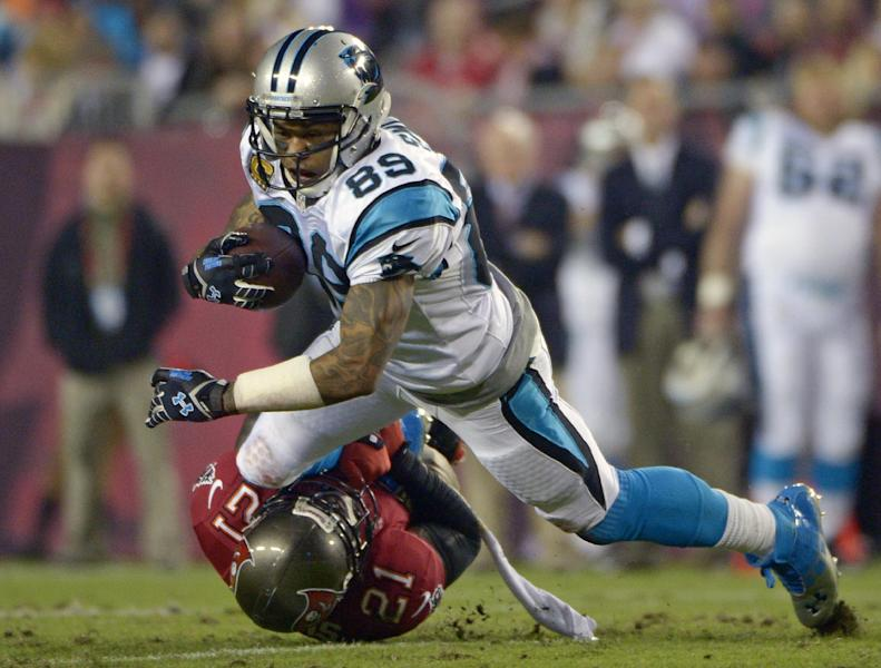 Carolina Panthers wide receiver Steve Smith (89) is brought down by Tampa Bay Buccaneers defensive back Michael Adams (21) after a reception during the first half of an NFL football game in Tampa, Fla., Thursday, Oct. 24, 2013. (AP Photo/Phelan M. Ebenhack)