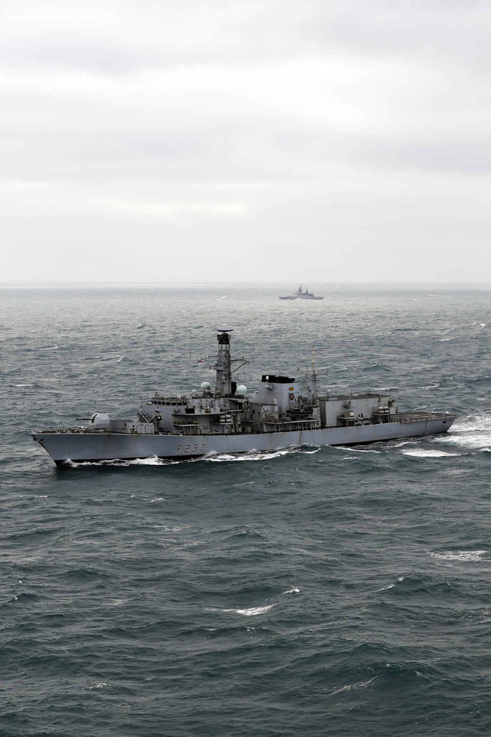The Royal Navy warship HMS Westminster (foreground) with the Russian frigate Boiky as it escorts four Russian vessels through the English Channel (Picture: PA)