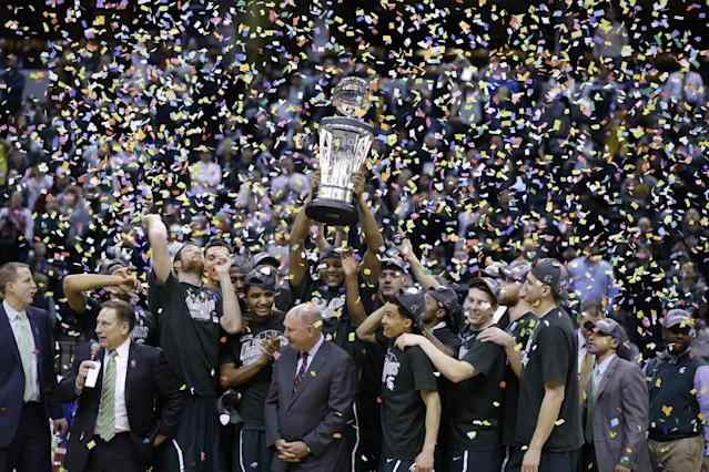 Michigan State players and coaches celebrate after they defeated Michigan 69-55 in an NCAA college basketball game in the championship of the Big Ten Conference tournament on Sunday, March 16, 2014, in Indianapolis. (AP Photo/Michael Conroy)
