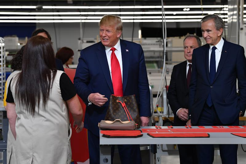 President Donald Trump and LVMH CEO and chairman Bernard Arnault touring Louis Vuitton's new facility in Texas