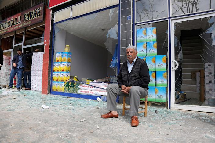 <p>A shop owner sits near the site of an explosion in Diyarbakir, Turkey, Tuesday, April 11, 2017. An explosion inside a workshop where a police armored vehicle was being repaired killed one man and injured a number of other people, Turkish police said Tuesday. The blast in the mainly Kurdish city of Diyarbakir caused part of the workshop — an annex to the city's main police headquarters — to collapse.(AP Photo) </p>