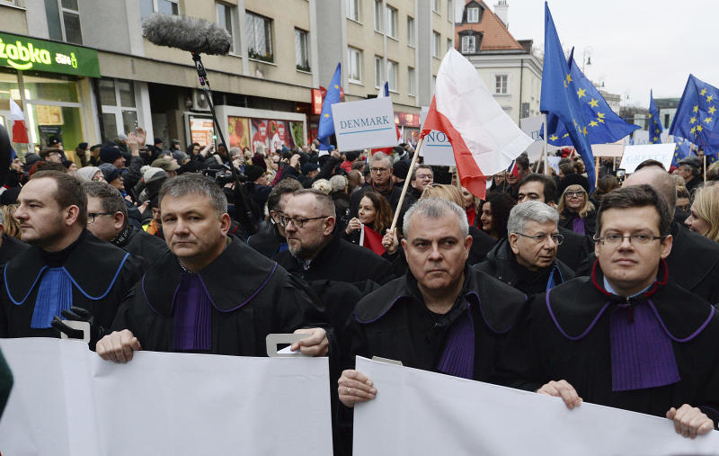 Judges and lawyers from across Europe, many of them dressed in their judicial robes, march silently in Warsaw, Poland, Saturday, Jan. 11, 2020. The rally was a show of solidarity with Polish judges, who are protesting a bill that would allow the government to fire judges whose rulings they don't like. The legislation has been denounced by the European Union and the United Nations. (AP Photo/Czarek Sokolowski)