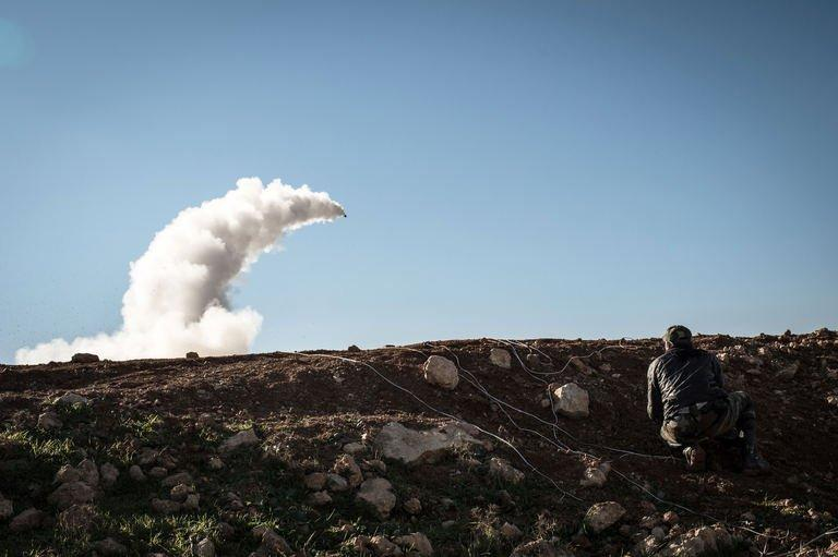 "Syrian rebels launch a missile near the Abu Baker brigade in Albab, 30 kilometres from the northeastern Syrian city of Aleppo, on January 16, 2013. More than 100 civilians have been killed in a new ""massacre"" in Syria, a watchdog said Thursday, as Russia slammed the United States for blaming deadly blasts at a university campus on the Damascus regime"