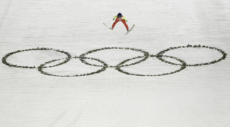 Austria's Daniela Iraschko-Stolz makes her first attempt during the women's normal hill ski jumping final at the 2014 Winter Olympics, Tuesday, Feb. 11, 2014, in Krasnaya Polyana, Russia. (AP Photo/Matthias Schrader)