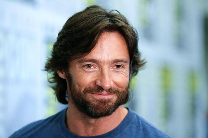 """FILE - In this July 24, 2008 file photo, actor Hugh Jackman attends the Comic-Con 2008 convention in San Diego. Attending Comic-Con is often a once-in-a-lifetime opportunity for many con-goers, but it's just another summertime destination for the likes of """"The Wolverine"""" star Jackman, geeky funnyman Patton Oswalt and """"The Amazing Spider-Man"""" sequel writers Alex Kurtzman and Roberto Orci. (AP Photo/Denis Poroy, file)"""