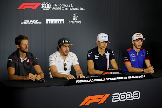 Formula One F1 - French Grand Prix - Circuit Paul Ricard, Le Castellet, France - June 21, 2018 Haas' Romain Grosjean, McLaren's Fernando Alonso, Force India's Esteban Ocon and Toro Rosso's Pierre Gasly during the press conference REUTERS/Jean-Paul Pelissier