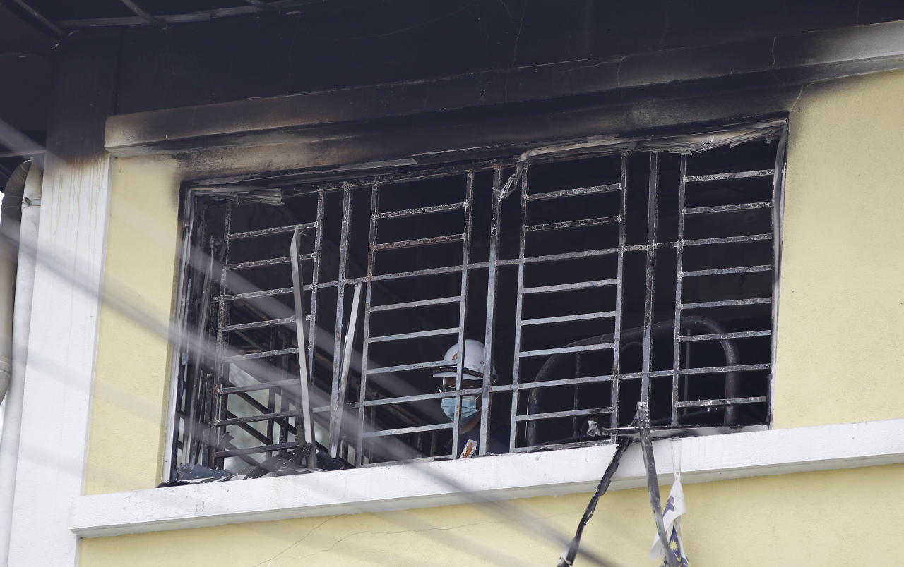 <p>Forensic police officer investigates burnt windows at an Islamic religious school following a fire on the outskirts of Kuala Lumpur Thursday, Sept. 14, 2017. (Photo: Daniel Chan/AP) </p>