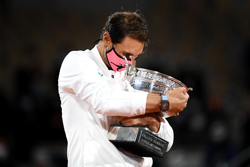 PARIS, FRANCE - OCTOBER 11: Rafael Nadal of Spain hugs the winners trophy following victory in his Men's Singles Final against Novak Djokovic of Serbia on day fifteen of the 2020 French Open at Roland Garros on October 11, 2020 in Paris, France. (Photo by Shaun Botterill/Getty Images)